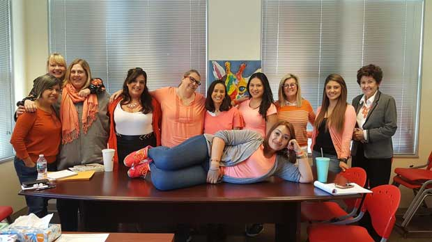 """""""Staff Orange4Love"""" Photo courtesy of NEWS- Domestic Violence and Sexual Abuse Services"""