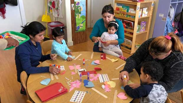 """Team working with children"" Photo courtesy of Family Life Education"